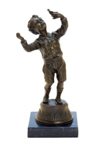 Antique bronze figurine depicting a boy playing with a bird